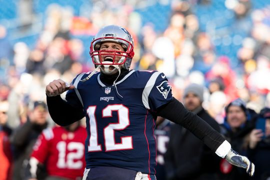 New England Patriots quarterback Tom Brady (12) reacts during warmups before a game against the Los Angeles Chargers in an AFC Divisional playoff football game at Gillette Stadium