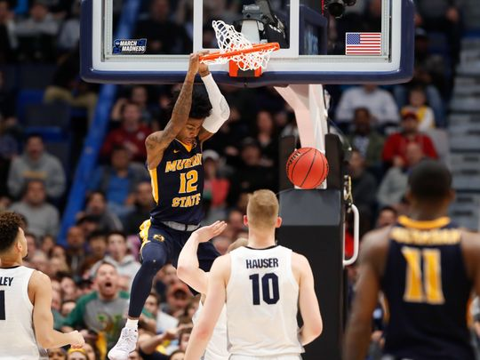 Murray State guard Ja Morant dunks against Marquette