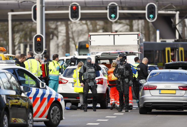 Police forces stand at the 24 Oktoberplace in Utrecht, on March 18, 2019 where a shooting took place.