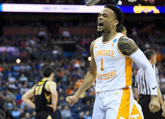 Tennessee guard Lamonte Turner (1) celebrates a foul against Iowa during the first half Sunday