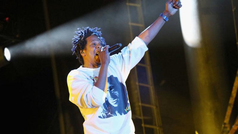Jay-Z performs at the Something in the Water festival in Virginia Beach, Va., on Saturday. The rapper was one of the many artists who had been scheduled to perform at Woodstock 50
