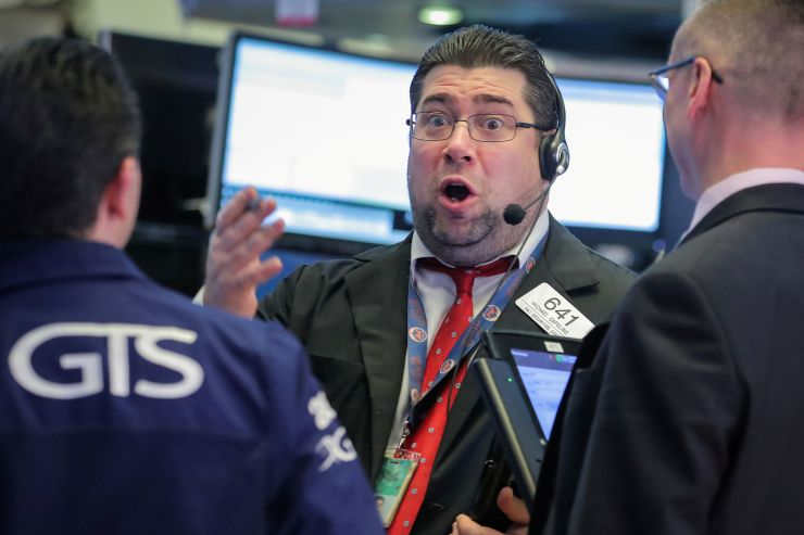 Traders work on the floor of the New York Stock Exchange in New York February 13 2019