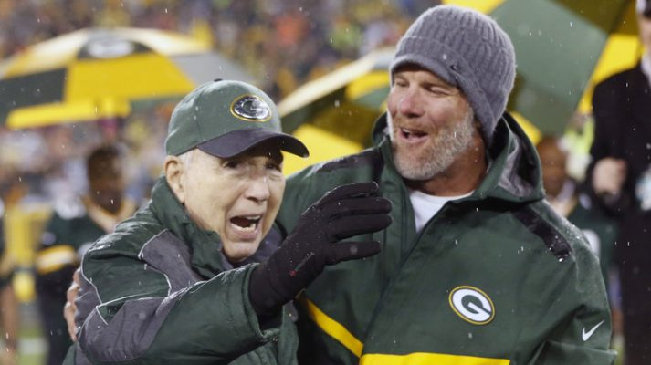 Brett Favre, right, stands with Bart Starr at a 2015 Green Bay Packers game