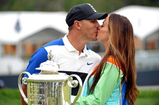 Brooks Koepka celebrates winning the PGA Championship with a long-awaited kiss from his girlfriend, Jena Sims