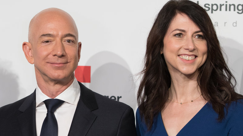 MacKenzie Bezos, one of the wealthiest women in the world, says she'll give at least half her fortune to charity. She's seen here in April 2018 with her now-former husband, Amazon founder Jeff Bezos