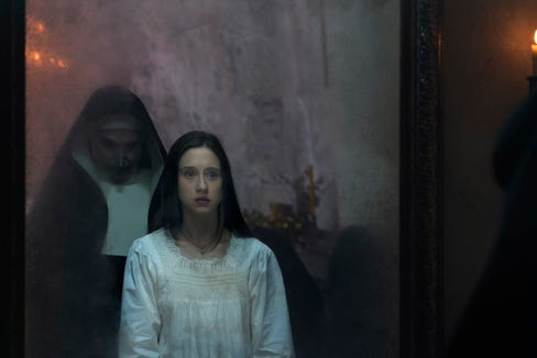 """Sister Irene (Taissa Farmiga) is haunted by the demonic nun Valak (Bonnie Aarons) in the """"Conjuring"""" spinoff """"The Nun."""""""