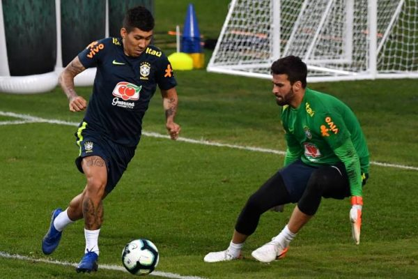Brazil's Roberto Firmino (L) and goalkeeper Alisson (R) take part in a training session at the Pacaembu stadium, in Sao Paulo, Brazil, on June 11 ahead of the Copa America football tournament