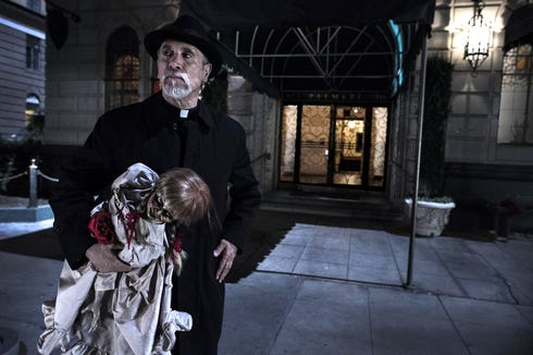 """Father Perez (Tony Amendola) has a serious doll problem to deal with in """"Annabelle."""""""