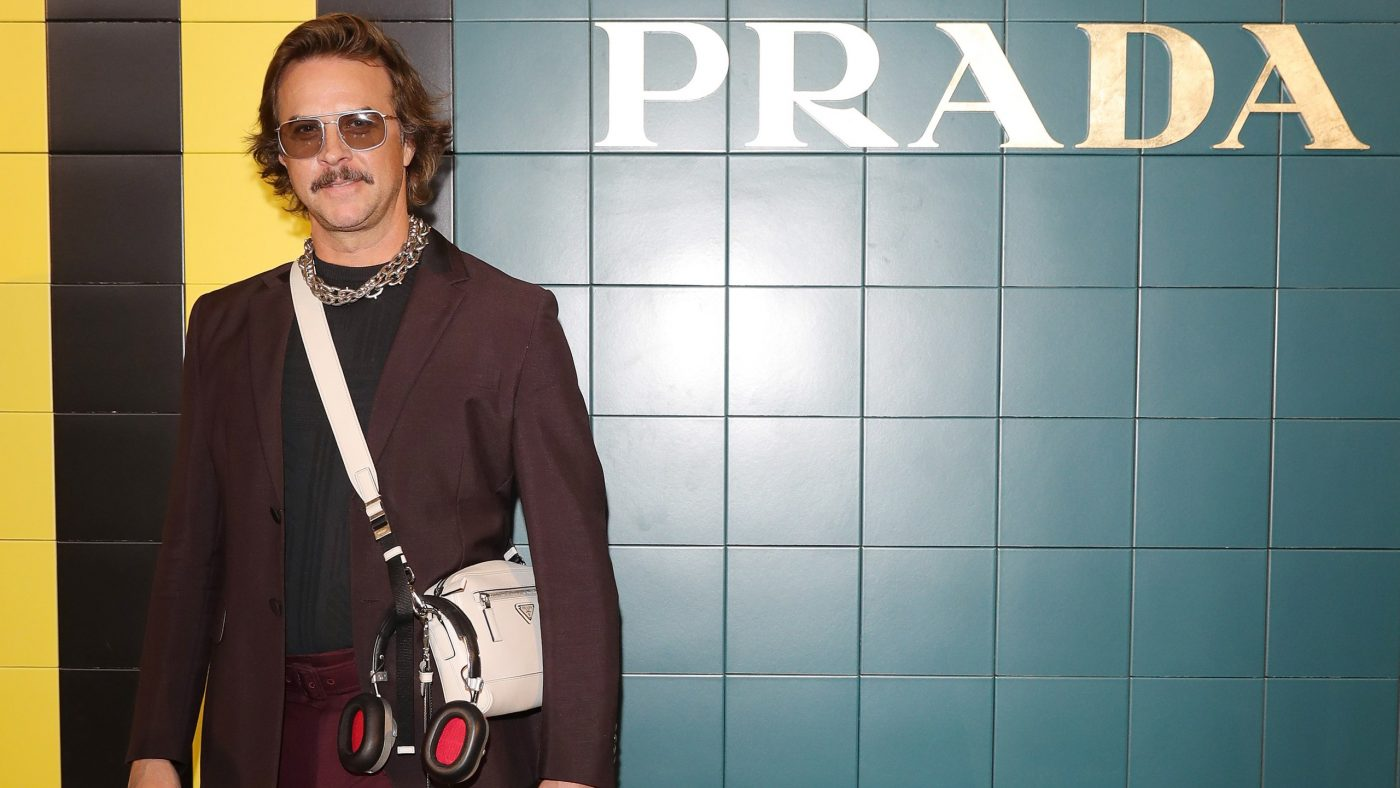 Casey Spooner Takes on the Prada Show in Extremely Short Shorts